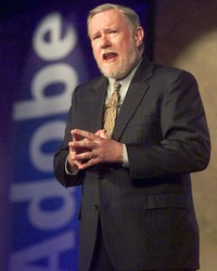 In this June 24, 1999, file photo, Dr. Charles M. Geschke, president, co-chairman and co-founder of Adobe Systems Inc., delivers his keynote address about the future of workplace information on the final day of PC Expo at New York's Jacob K. Javits Convention Center. (AP Photo/Richard Drew, File)