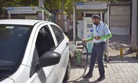 A driver of an electric car charges his vehicle at public charging station in New Delhi, India, on April 1, 2021. (AP Photo/Neha Mehrotra)