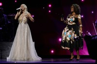 Carrie Underwood, left, and CeCe Winans perform at the 56th annual Academy of Country Music Awards on April 17, 2021, at the Grand Ole Opry in Nashville, Tennessee. (AP Photo/Mark Humphrey)