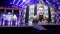 Luke Bryan appears on screen accepting the award for entertainer of the year at the 56th annual Academy of Country Music Awards on April 18, 2021, at the Grand Ole Opry in Nashville, Tennessee. (AP Photo/Mark Humphrey)