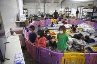 In this March 30, 2021 file photo, young unaccompanied migrants, from ages 3 to 9, watch television inside a playpen at the U.S. Customs and Border Protection facility, the main detention center for unaccompanied children in the Rio Grande Valley, in Donna, Texas. (AP Photo/Dario Lopez-Mills, Pool)