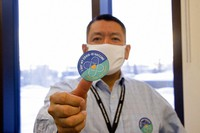 In this undated photo provided by the Tanana Chiefs Conference, shows PJ Simon, chief and chairman of the conference, from Fairbanks, Alaska, displaying a COVID-19 vaccination sticker. (Rachel Saylor/Tanana Chiefs Conference via AP)