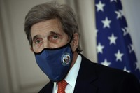 U.S. special envoy for climate John Kerry attends a news conference on March 11, 2021, in Paris. (AP Photo/Christophe Ena)