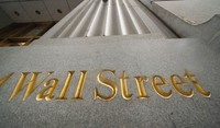 In this Nov. 5, 2020 file photo, a sign for Wall Street is carved in the side of a building. (AP Photo/Mark Lennihan)
