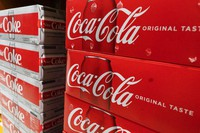 In this April 5, 2021 file photo, cases of Coca-Cola are displayed in a supermarket, in New York. (AP Photo/Mark Lennihan)