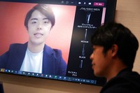 Naruhiko Ito, assistant brand manager of Brand Shiseido Group, demonstrates Shiseido released AR makeup filter for men to use for online meetings in Tokyo on April 15, 2021. (AP Photo/Eugene Hoshiko)