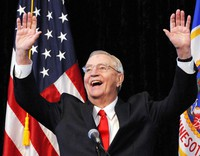 In an Oct. 30, 2012, file photo, former Vice President Walter Mondale, a former Minnesota senator, gestures while speaking at a Students for Obama rally at the University of Minnesota's McNamara Alumni Center in Minneapolis. (AP Photo/Jim Mone)