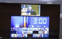 European Union foreign policy chief Josep Borrell, top of screen, speaks with EU foreign ministers via video link at the European Council building in Brussels, on April 19, 2021. (Francois Walschaerts, Pool via AP)