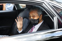 Malaysia's former Prime Minister Mahathir Mohamad waves as he leaves national palace in Kuala Lumpur, Malaysia, on April 20, 2021. (AP Photo/FL Wong)