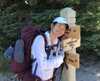 In this photo provided by Noriko Nasu, she is seen mountain hiking in Oregon in August 2019, about a year and a half before she was assaulted.
