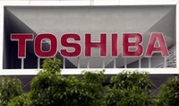 This May 26, 2017, file photo shows the company logo of Toshiba Corp. displayed in front of its headquarters in Tokyo. Toshiba Corp. (AP Photo/Koji Sasahara)