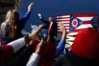 In this Oct. 12, 2018 file photo then President Donald Trump waves as he arrives for a campaign rally, in Lebanon, Ohio. (AP Photo/Evan Vucci)
