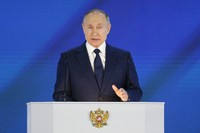 Russian President Vladimir Putin gives his annual state of the nation address in Manezh, Moscow, Russia, on April 21, 2021. (AP Photo/Alexander Zemlianichenko, Pool)