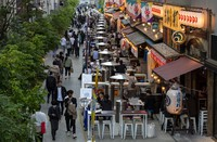 People sit in the outdoor seating areas of restaurants and bars on April 20, 2021, in Tokyo. (AP Photo/Kiichiro Sato)