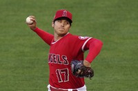 Shohei Ohtani of the Los Angeles Angels pitches during the first inning of a baseball game against the Texas Rangers on April 20, 2021, in Anaheim, California. (AP Photo/Mark J. Terrill)