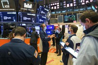 In this photo provided by the New York Stock Exchange, traders work on the floor, on April 21, 2021.  (Courtney Crow/New York Stock Exchange via AP)