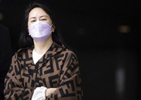 In this March 31, 2021, file photo, Chief Financial Officer of Huawei, Meng Wanzhou, returns to British Columbia Supreme Court after a break from her extradition hearing, in Vancouver, British Columbia. (Darryl Dyck/The Canadian Press via AP)