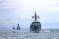 This handout photo released on April 14, 2021 by Russian Defense Ministry Press Service shows, Russian navy ships during navy drills in the Black Sea. (Russian Defense Ministry Press Service via AP)