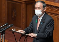 Japanese Prime Minister Yoshihide Suga speaks during a House of Councillors plenary session at the Diet in Tokyo on April 21, 2021. (Mainichi/Kan Takeuchi)