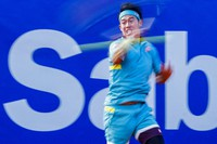 Japan's Kei Nishikori returns the ball to Chile's Cristian Garin during the Godo tennis tournament in Barcelona, Spain, on April 21, 2021. (AP Photo/Joan Monfort)