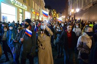People with Russian national flags attend the opposition rally in support of jailed opposition leader Alexei Navalny in Moscow, Russia, on April 21, 2021. (AP Photo/Denis Kaminev)