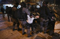 Israeli riot police detain a Palestinian man during clashes near Damascus Gate just outside Jerusalem's Old City, on April. 22, 2021. (AP Photo/Mahmoud Illean)