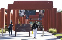 In this April 25, 2019, photo students walk past the Harriet and Charles Luckman Fine Arts Complex at the Cal State University, Los Angeles campus. (AP Photo/Damian Dovarganes, File)