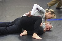 Eve Steffans of the Martial Arts Academy in Billings, Montana, practices judo techniques on Ed Thompson, a retired police officer, during a training session, March 9, 2021, in Douglas, Wyoming. (AP Photo/Eddie Pells)
