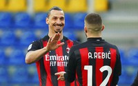 Milan's Ante Rebic celebrates after scoring his side's first goal, with teammate Zlatan Ibrahimovic, who gave him the assist, during the Italian Serie A soccer match between Parma and Milan at the Ennio Tardini stadium in Parma, Italy, on April 10, 2021. (Spada/LaPresse via AP)