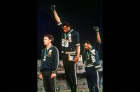 In this Oct. 16, 1968 file photo, U.S. athletes Tommie Smith, center, and John Carlos raise their gloved fists after Smith received the gold and Carlos the bronze for the 200 meter run at the Summer Olympic Games in Mexico City. (AP Photo)