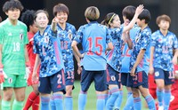 Japan players celebrate after their 7-0 win over Panama in a women's football friendly on April 11, 2021, at Tokyo's National Stadium.(Mainichi/Yuki Miyatake)