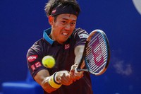 Japan's Kei Nishikori returns the ball to Spain's Rafael Nadal during the Godo tennis tournament in Barcelona, Spain, on April 22, 2021. (AP Photo/Joan Monfort)