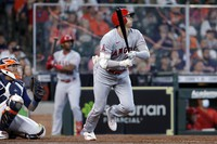 Los Angeles Angels designated hitter Shohei Ohtani, right, watches his home run in front of Houston Astros catcher Martin Maldonado, left, during the eighth inning of a baseball game on April 25, 2021, in Houston. (AP Photo/Michael Wyke)