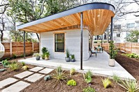 This photo provided by ICON shows one of its 3D-printed homes in Austin, Texas. (Regan Morton Photography/Courtesy of ICON via AP)