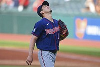 Minnesota Twins starting pitcher Kenta Maeda (18) reacts after giving up a solo home run in the first inning of a baseball game, on April 27, 2021, in Cleveland. (AP Photo/David Dermer)