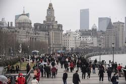 中国経済は堅調に回復を続けるように見えるが……(上海) (Bloomberg)