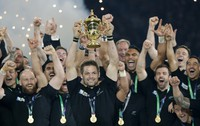 In this Oct. 31, 2015 file photo, New Zealand's captain Richie McCaw holds the trophy aloft after the Rugby World Cup final between New Zealand and Australia at Twickenham Stadium in London. (AP Photo/Christophe Ena)