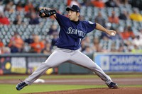 Seattle Mariners starting pitcher Yusei Kikuchi throws against the Houston Astros during the first inning of a baseball game on April 29, 2021, in Houston. (AP Photo/Michael Wyke)