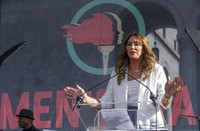 In this Jan. 18, 2020, file photo, Caitlyn Jenner speaks at the fourth Women's March in Los Angeles. (AP Photo/Damian Dovarganes)