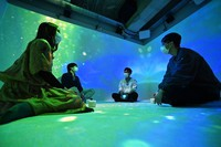 Ricoh Co. employees are seen engaging in programs to facilitate meditation and socializing at Ricoh Prism, a conference room using sound and video technology, in Tokyo's Ota Ward on April 15, 2021. (Mainichi/Takehiko Onishi)