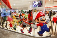 In this Jan. 23, 2020, file photo, Nintendo characters, including Mario, right, are seen on a glass of its official store in Tokyo. (AP Photo/Jae C. Hong)