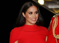 In this March 7, 2020 file photo, Meghan, Duchess of Sussex with Prince Harry arrives at the Royal Albert Hall in London, to attend the Mountbatten Festival of Music. (Simon Dawson/Pool via AP)