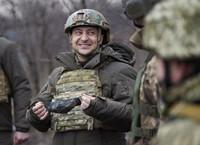 In this Feb. 11, 2021 file photo, Ukrainian President Volodymyr Zelenskyy talks with servicemen as he visits the war-hit Donetsk region, eastern Ukraine. (Ukrainian Presidential Press Office via AP)