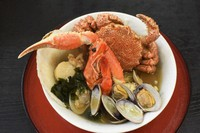 An Enmantei seafood ramen covered with toppings such as hairy crab, prawn, scallop and clams is seen in Higashimatsushima, Miyagi Prefecture, on April 16, 2021. (Mainichi/Ami Jinnai)