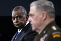 Defense Secretary Lloyd Austin, left, listens as Chairman of the Joint Chiefs of Staff Gen. Mark Milley, right, speaks during a briefing at the Pentagon in Washington, on May 6, 2021. (AP Photo/Susan Walsh)