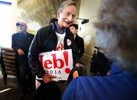 In this Feb. 10, 2016, file photo, Jonathan Bush, talks at a campaign event at Mount Pleasant's Memorial Waterfront Park with signs for his nephew, former Florida Gov. Jeb Bush. (Wade Spees/The Post And Courier via AP)