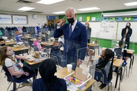 In this May 3, 2021, photo, President Joe Biden gestures as he talks to students during a visit to Yorktown Elementary School, in Yorktown, Va., as first lady Jill Biden watches. (AP Photo/Evan Vucci)