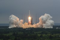 In this April 29, 2021 file photo released by China's Xinhua News Agency, a Long March 5B rocket carrying a module for a Chinese space station lifts off from the Wenchang Spacecraft Launch Site in Wenchang in southern China's Hainan Province. (Ju Zhenhua/Xinhua via AP)