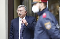 Russia's Governor to the International Atomic Energy Agency (IAEA), Mikhail Ulyanov has a cigarette break outside of the 'Grand Hotel Wien' where closed-door nuclear talks with Iran take place in Vienna, Austria, on May 7, 2021. (AP Photo/Lisa Leutner)