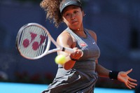 Naomi Osaka of Japan returns the ball to Karolina Muchova of the Czech Republic during their match at the Madrid Open tennis tournament in Madrid, Spain, on May 2, 2021. (AP Photo/Paul White)